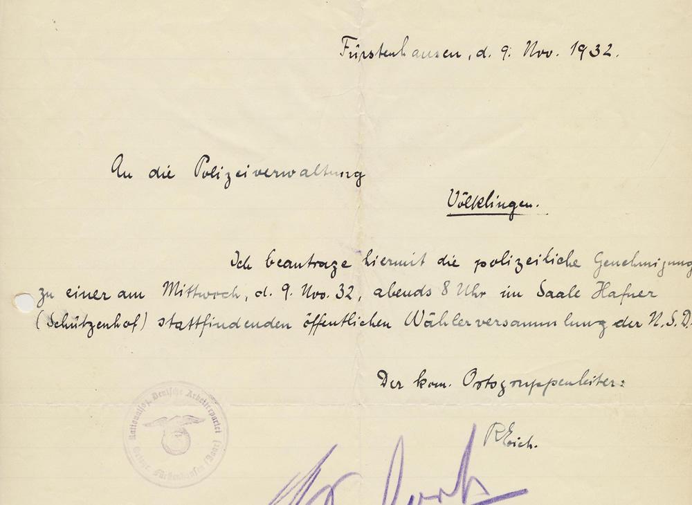Der kommissarische Ortsgruppenleiter der NSDAP-Ortsgruppe Fürstenhausen, Rudolf Eich, meldet kurz vor den Kommunalwahlen eine Veranstaltung an.