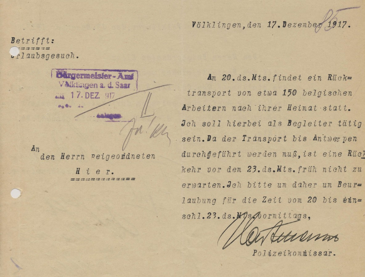 Urlaubsgesuch des Polizeikommissars Hartmann wegen der Begleitung eines Rücktransports belgischer Arbeiter nach Antwerpen.
